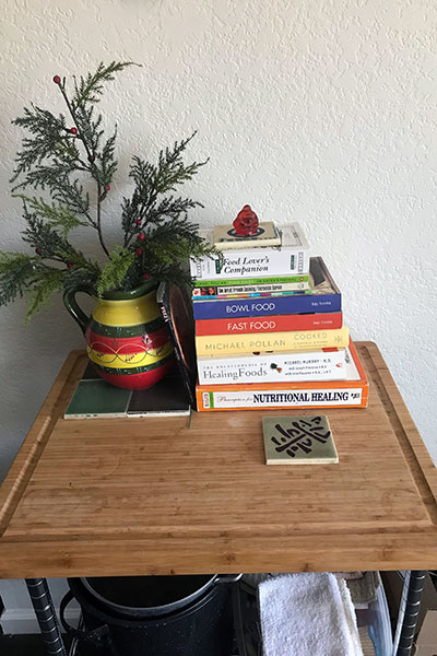 Photo of top of microwave stand with books