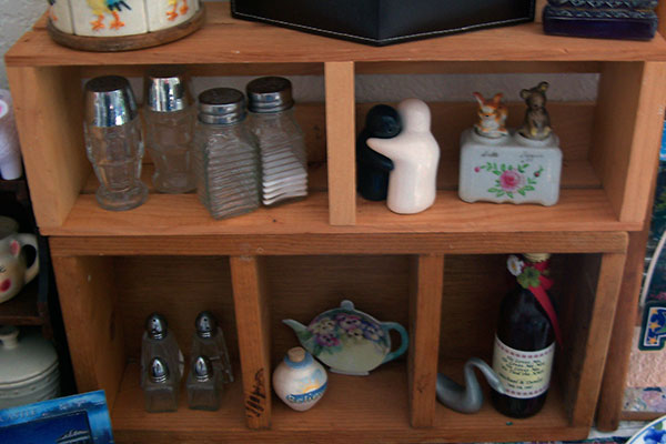 Photo of salt and pepper shakers on a wooden display case